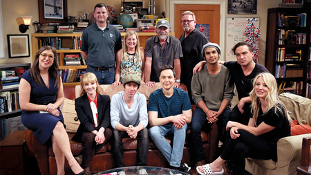 The cast and creators of the show sit together to take a final on set photo.