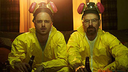 Aaron Paul and Bryan Cranston are enjoying a beer after finishing their meth cook.