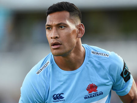 Israel Folau looks off camera as he is on field playing rugby.
