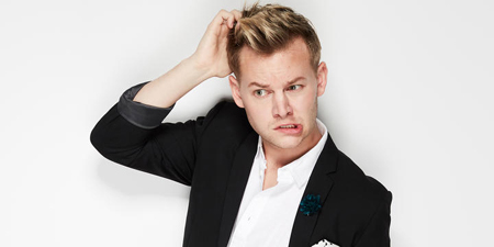 Joel Creasey scratches his head and twists his mouth during a photo shoot.