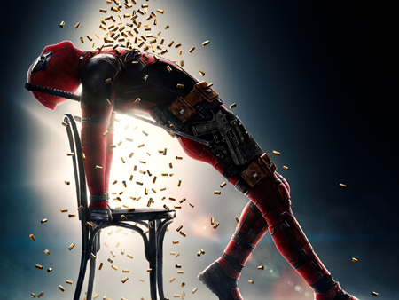 Deadpool mocks a popular music video as he arches forward and shell casings rains over him.