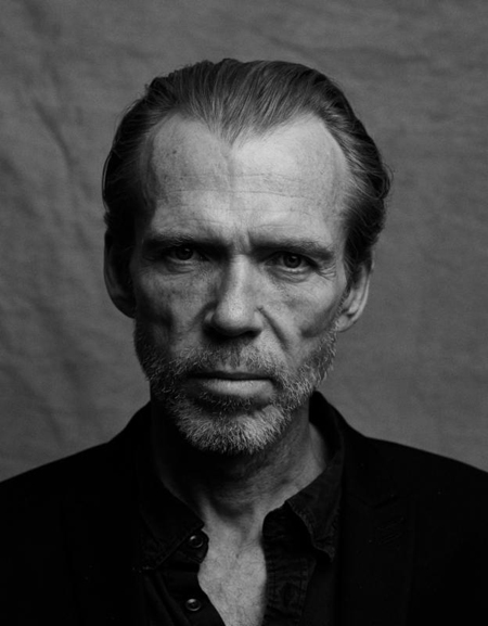 A black and white picture of Richard Brake.