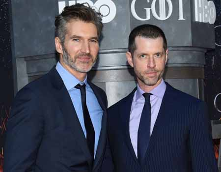 David Benioff and D.B. Weiss stand next to each other to take a photo.