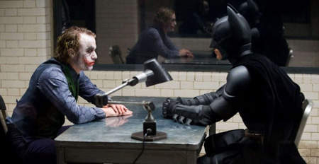 Batman and Joker sit across from each other.