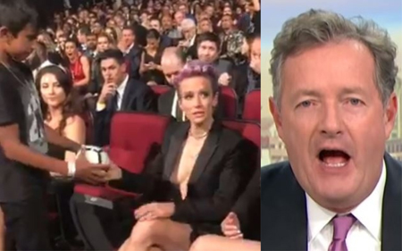 Megan Rapinoe signs a ball and Piers Morgan calls her out.