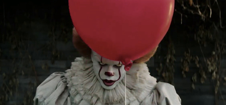 Pennywise holding a balloon.