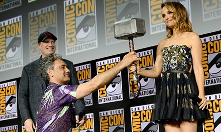 Taika Waititi hands over the hammer to Natalie Portman.