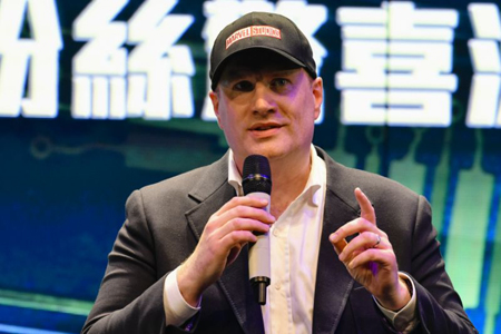 Kevin Feige on stage talking at a Marvel panel.