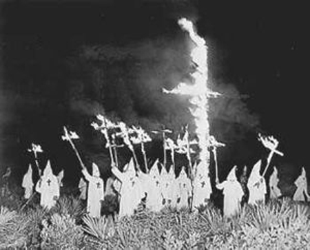 Cross burning by the Ku Klux Klan.