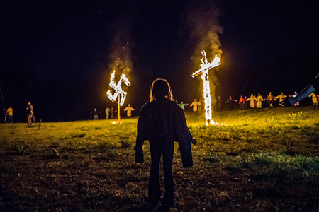 The burning of a Swastika and Cross.