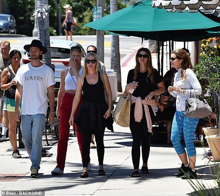 Katherine Schwarzenegger (second right) with her mother Maria Shriver (right), brother Patrick (left) and his girlfriend Abby Champion (second left)