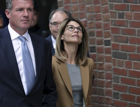 Lori Loughlin departs federal court in Boston on Wednesday, April 3, 2019. She was confident she and her husband wouldn't face any charges