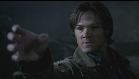 Sam with black eyes is using his demon powers.