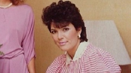 Kris Jenner with a perm in an early photo.