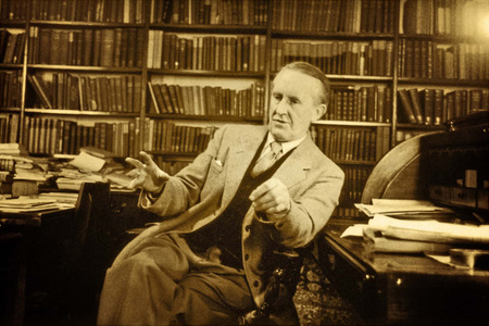 Tolkien is seen inside a library talking to someone off screen.