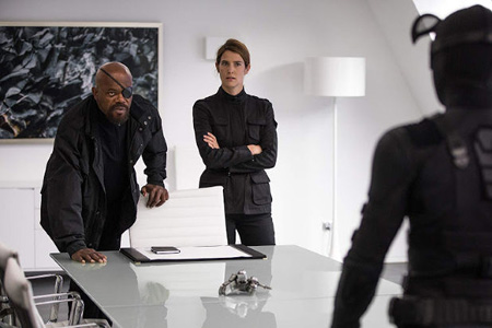 Nick Fury and Maria Hill seen inside a meeting room with spider man.