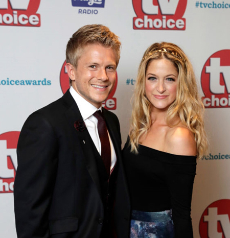 George Rainsford and wife Jaimi Barbakoff.