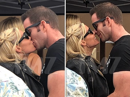 Tarek El Moussa and Heather Rae Young were spotted kissing on a yacht on July 29.