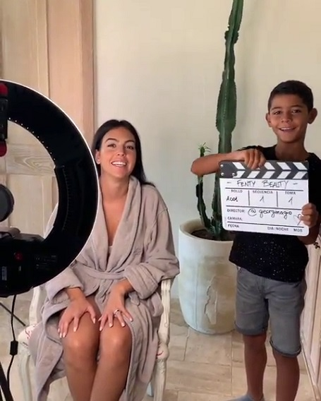 Cristiano Ronaldo Jr. with the clapperboard at the video tutorial shooting of Fenty Beauty.
