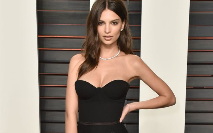 Emily Ratajkowski Looks Gorgeous In This Polka-Dot Dress With A Classic Meghan Markle Sneaker