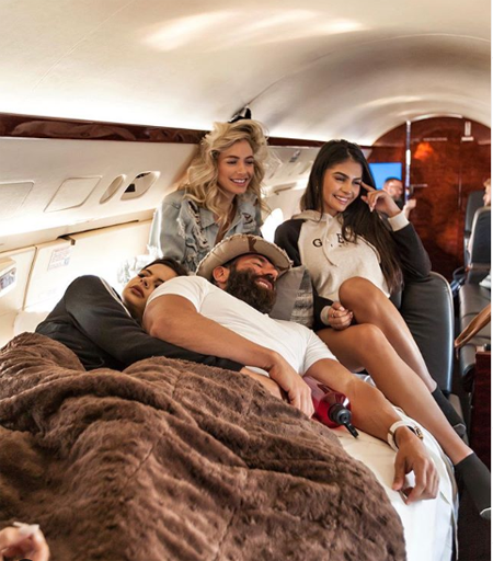 Dan Bilzerian in a private jet with some models.