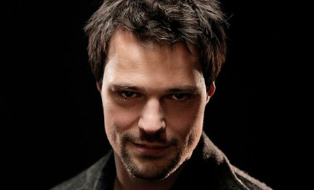 Danila with a smirk, looking into the camera