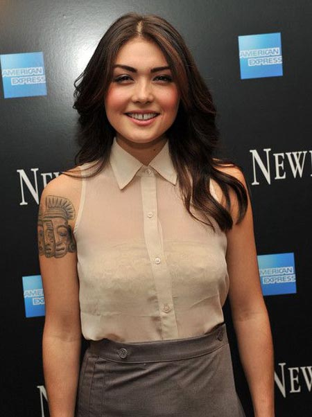 Daniella Pineda wearing a net shirt.