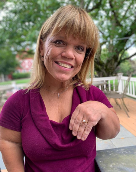 Amy Roloff showing off her heart-shaped diamond ring.
