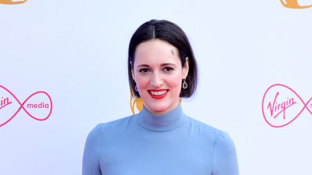 Phoebe Waller-Bridge at a red carpet event wearing a blue high-neck.