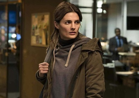 Stana Katic on the show 'Absentia' wearing a hoodie and a jacket.