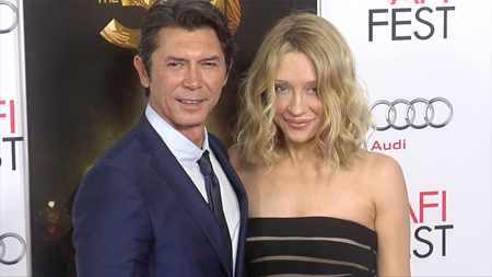 Lou Diamond Phillips with his wife Yvonne at a red carpet event.
