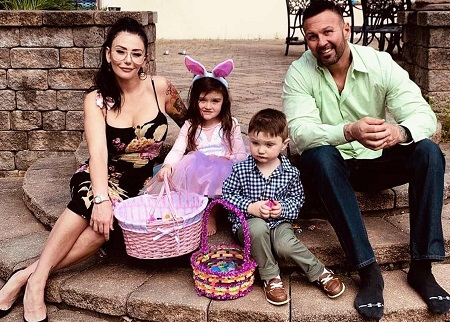 Jenni Farley and Roger Mathews with their kids during Easter 2019 in his house.