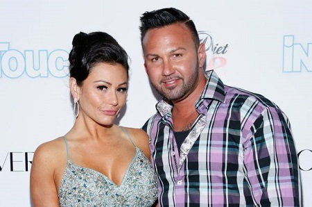 "Roger Mathews and ex-wife Jenni ""JWoww"" Farley posing during an InTouchWeekly event."