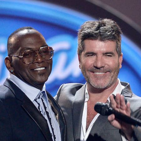 Randy Jackson on the stage of American Idol with co-judge Simon Cowell.
