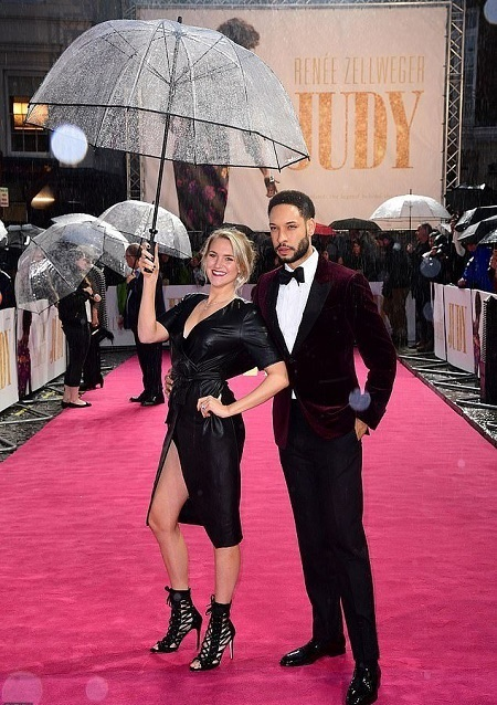 Pierreson's girlfriend also accompanied him to the European premiere of 'Judy'. She's holding a transparent plastic umbrella.