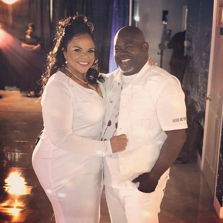 David and Tamela Mann in white dresses in the night and smiling together.