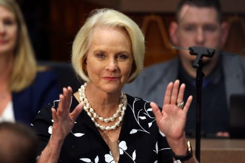 Cindy McCain in a black coat poses a picture.