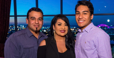Suzzette Quintanilla poses a picture with her husband and son.