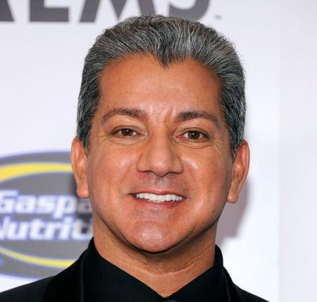 Bruce Buffer poses a picture at an event.