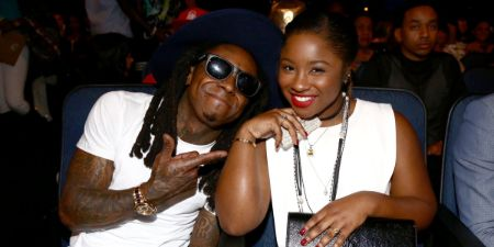 Reginae Carter poses a picture with her celebrity dad, Lil Wayne.