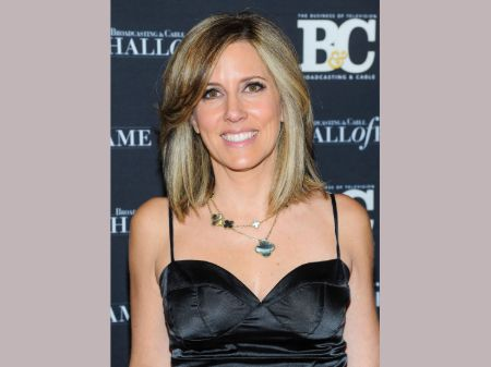 Alisyn Camerota in a black dress poses for a picture.