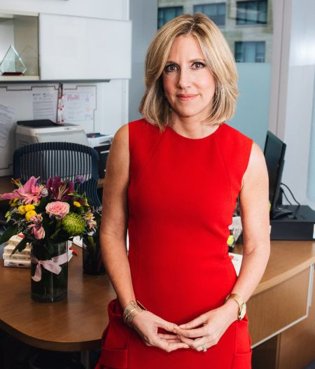 Alisyn Camerota poses for a picture in a red dress.