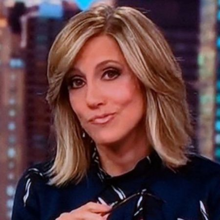 Alisyn Camerota in a black shirt poses for a picture.