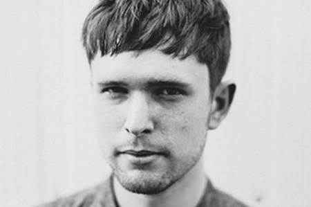 James Blake's black and white photo.