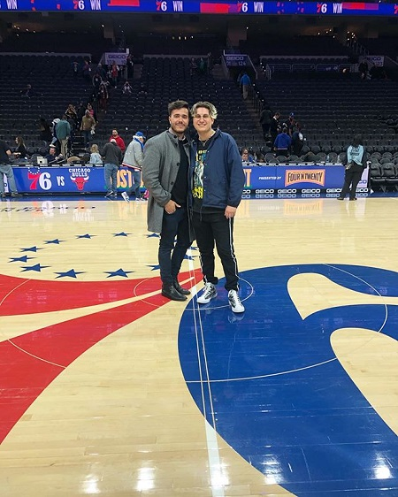 Anthony Lario and his brother Dominic Lario standing at the center of aa basketball court.