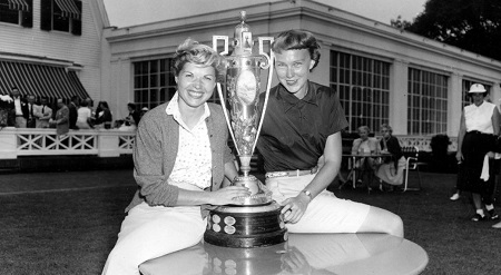 In this Sept. 17, 1954, file photo, Barbara Romack, left, and Mickey Wright pose with the championship cup after defeating their respective opponents to enter the final round of the Women's National Golf Championship, in Pittsburgh, Pa.