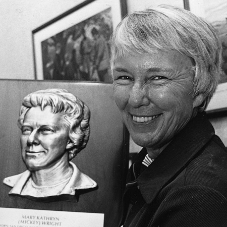 Mickey Wright holding a portrait of hers.