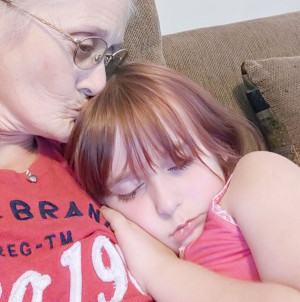 Faye Swetlik napping in her grandmother's arms..