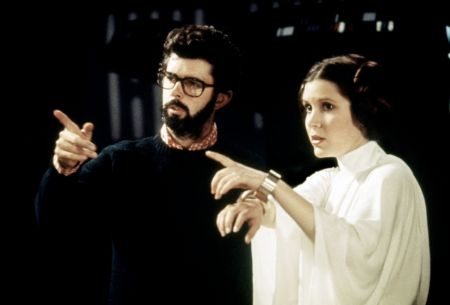 George Lucas with Carrie Fisher during Star Wars: Episode IV – A New Hope.
