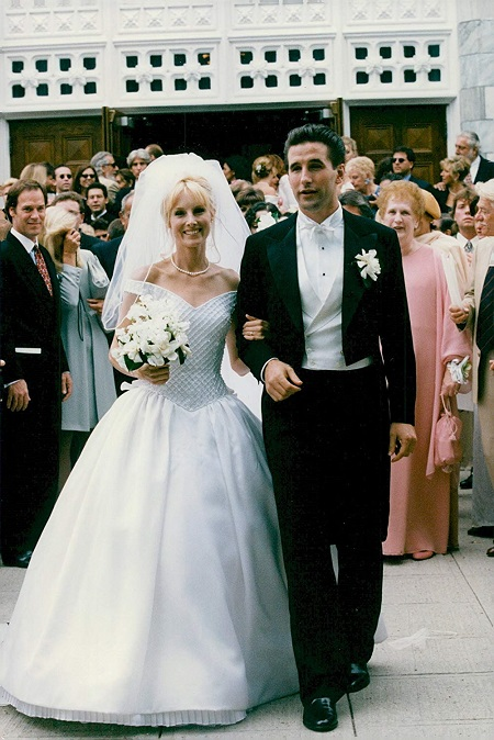 "William ""Billy"" Baldwin and wife Chynna Phillips in their wedding attires."